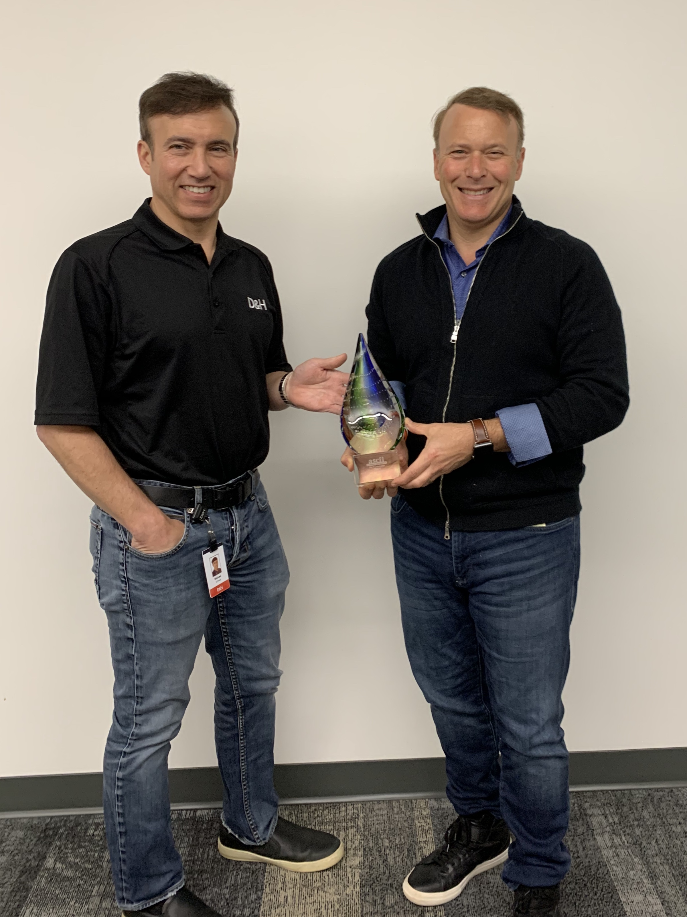 D&H Distributing Co-President Michael Schwab & Co-President Dan Schwab and with the ASCII Top Benchmark Survey Broadline Distributor of 2019 Award