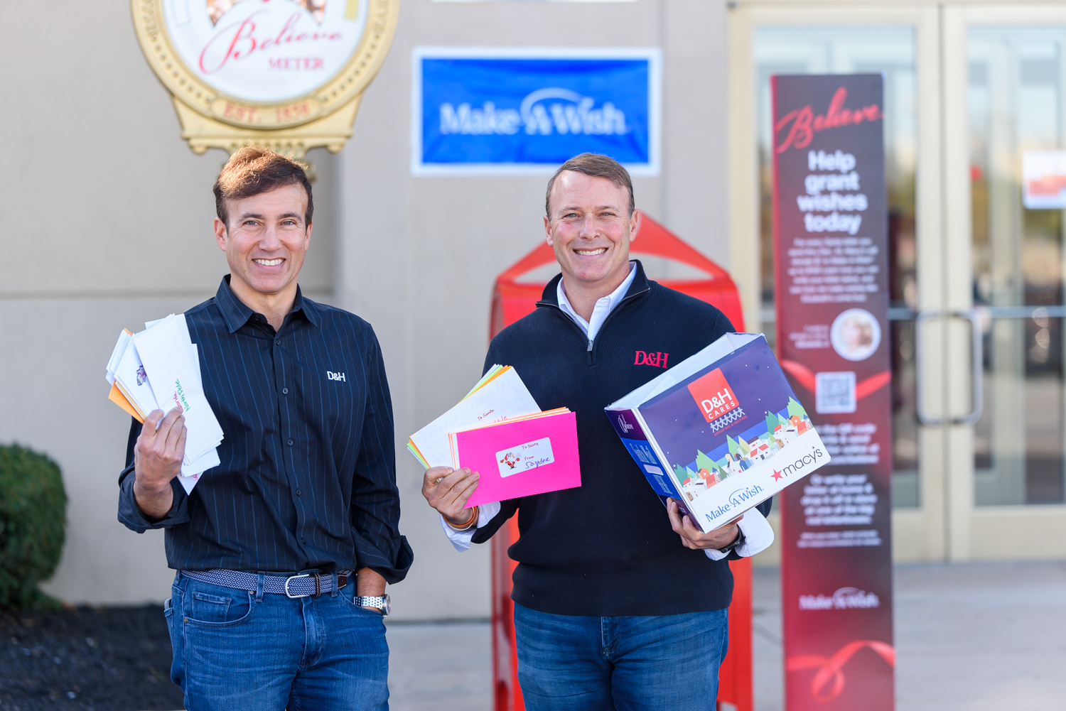 """D&H Distributing's Co-Presidents Michael Schwab (L) and Dan Schwab deliver """"Letters to Santa"""" at Macy's Camp Hill to benefit Make-A-Wish Philadelphia, Delaware & Susquehanna Valley, part of the Macy's Believe holiday fundraiser."""